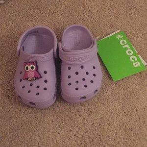 Brand new Crocs with charm!